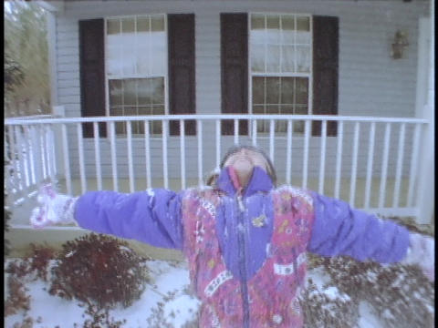 A girl throws snow above her head Footage