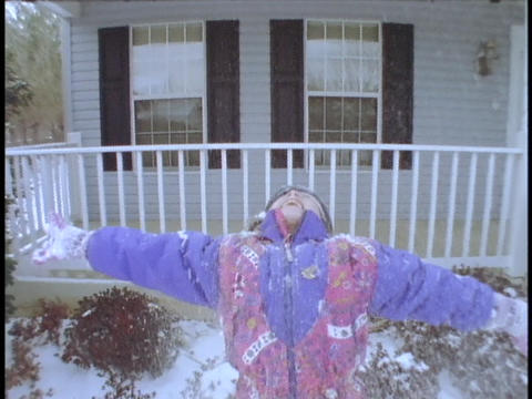 A girl throws snow above her head Stock Video Footage
