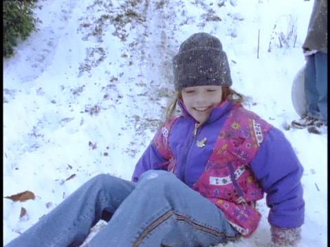 Children slide down a hill Stock Video Footage