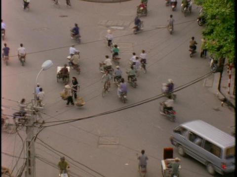 Bikes crowd a street in Hanoi, Vietnam Footage