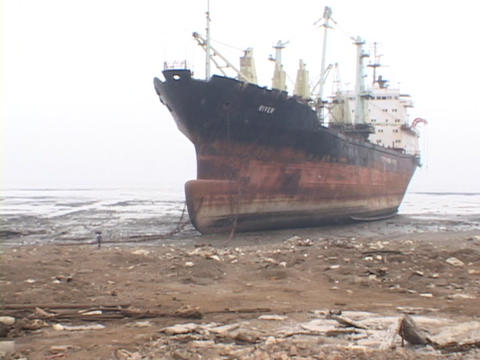 A ship sits beached on a remote peninsula Stock Video Footage
