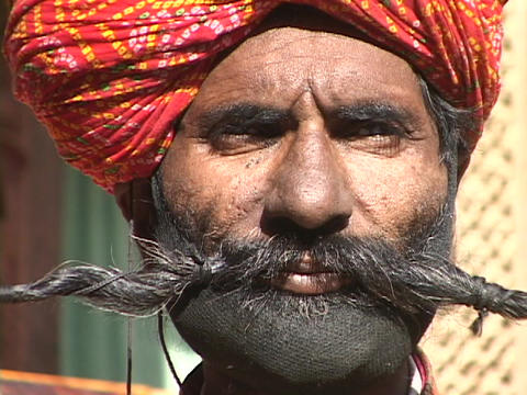 A man holds out his mustache with both hands Stock Video Footage