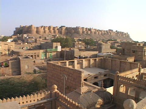 Buildings sit beneath Jaisalmer Stock Video Footage