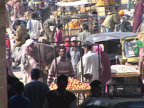 Shoppers walk through a busy market Stock Video Footage