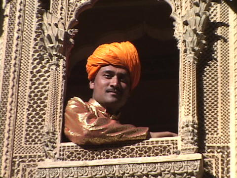 A king leans through the window of a palace balcony Stock Video Footage