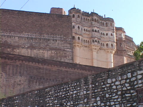 A large wall stands in front of a palace at Jodhpur Fort, India Footage