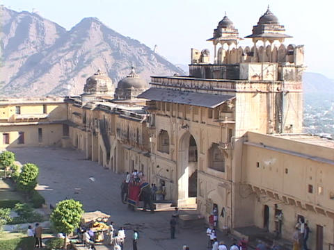 An elephant and riders enter palace gates in Rajasthan, India Footage