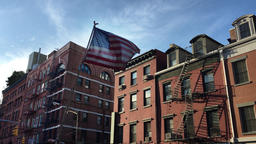 American Flag Flying by Apartment Buildings in New York's Little Italy Neighborh Footage