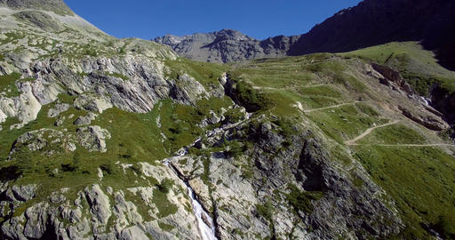 4K Aerial, Flying Above Waterfalls At Rifugio Scarfiotti, Italy Footage
