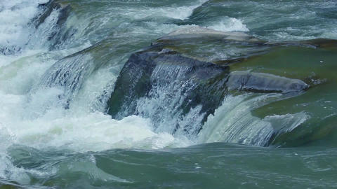 Fast mountain river rapid water flow on stones Footage