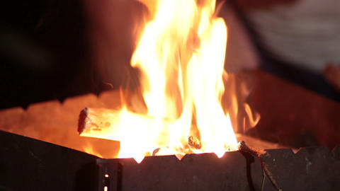 Close up burning wood in the barbecue at night Footage