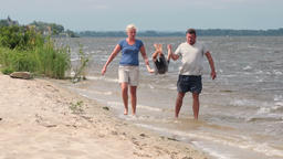 Family walking on the shore together on the beach Footage