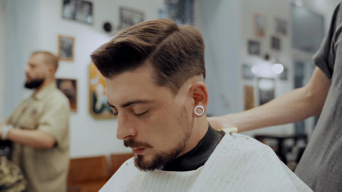 Close-Up Portrait Of Attractive Young Man Getting Trendy Haircut Live Action