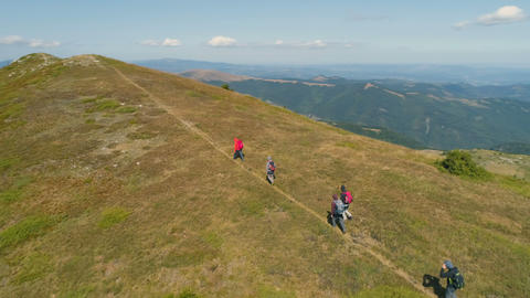 Balkan Mountains/Bulgaria - 27 08 2019: People with backpacks in mountain trek Live Action