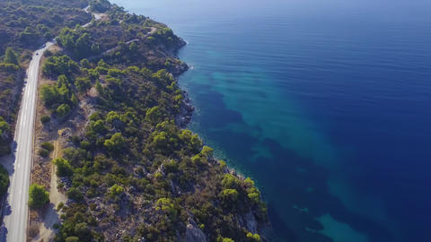 Aerial footage of road by the blue and turquoise crystal clear sea Footage