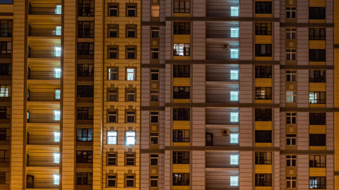 Apartment windows of big house in the evening time lapse Footage