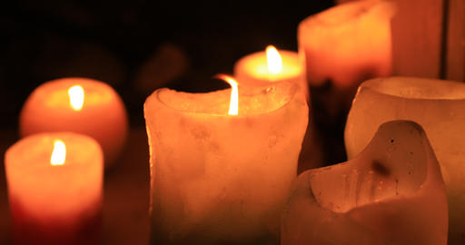 Burning romantic candles at night close up Footage