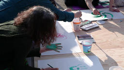 Women painting with watercolors, outside Live Action