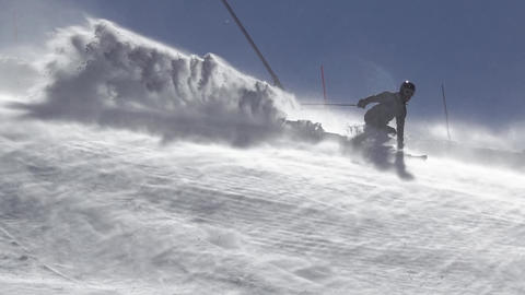 Skier Raises a lot of Snow Dust. Slow Motion Footage