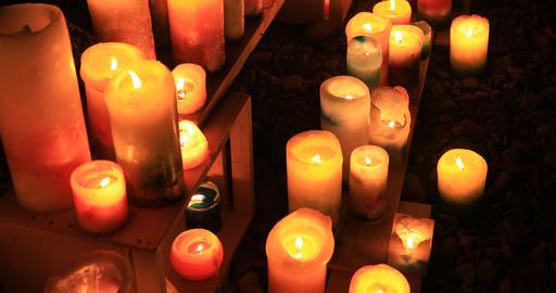 Burning romantic candles at night medium shot Live Action