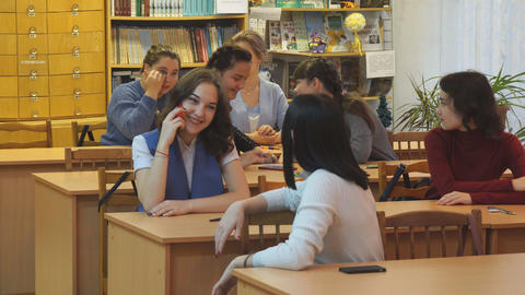 Students in the classroom at their desks Archivo