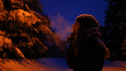 Girl smoking outside in winter, at night in the winter time Live Action