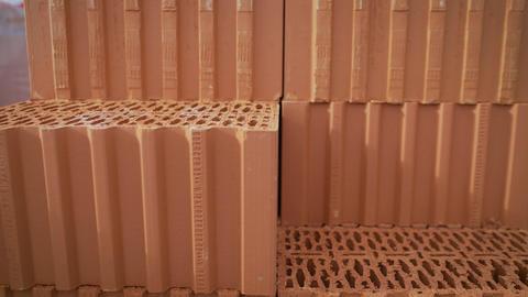 Isolated pile of builders bricks. Ceramic blocks stack Footage