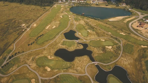 Aerial view of golf course and water Live Action
