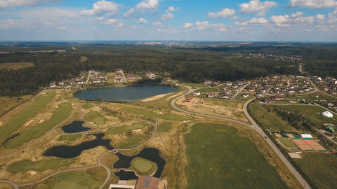 Aerial view of golf course and water Footage
