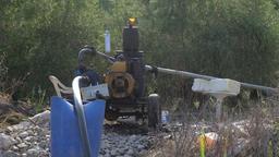 Diesel engine waterpump to water the fields, loopable in 4k Footage