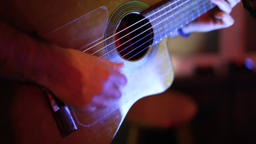 Guitarist plays to bar patrons by night Live Action
