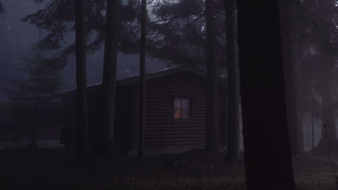 Cabin in dark misty woods. Tall pines throwing shadows on wooden cabin in the Live Action