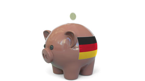 Putting money into piggy bank with flag of Gemany. Tax system system or savings Live Action