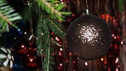 Green Christmas Tree Branch And Swinging Christmas Ball Footage