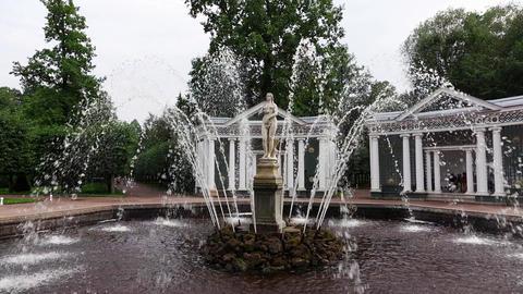Fountain water jets around Eve sculpture at Peterhof gardens, slow motion Footage