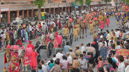 Brass band and bullock carts with cannon's,Jaipur,Gangaur,India Footage