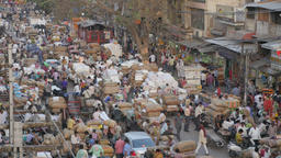 Busy market with manual labour transport of jute bags,New Delhi,India Footage