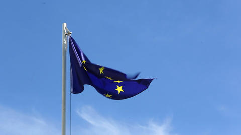 Flag of European Union in front of blue sky Live Action