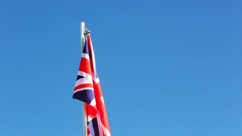 Textile flag of UK with little wind Live Action