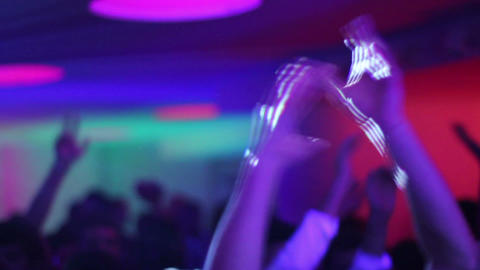 Clapping and waving hands raised up in the air in night club Footage