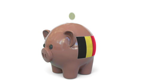 Putting money into piggy bank with flag of Belgium. Tax system system or savings Live Action