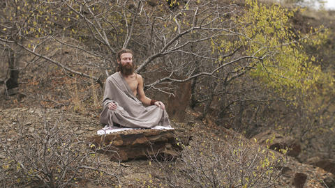 Yogi meditating at mountains in autumn Footage