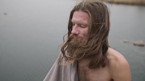 Yogi meditates on the river bank ビデオ