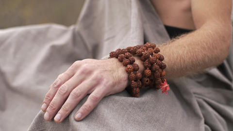 Hand of meditating yogi on nature Footage
