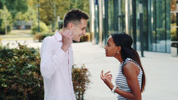 Young man accusing his mixed-race girlfriend of betrayal outdoors Footage
