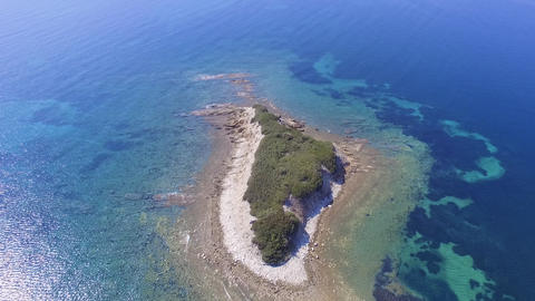 Aerial drone footage of little island in blue and turquoise sea. Bird view of beautiful little Live Action