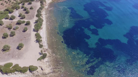 Aerial drone footage of coast with beautiful nature by the blue and turquoise crystal clear sea Footage
