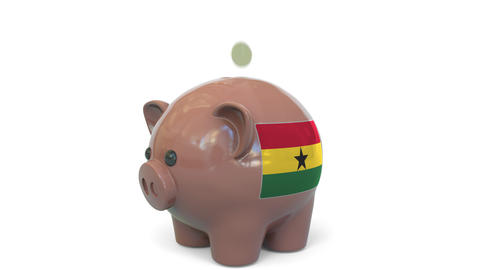 Putting money into piggy bank with flag of Ghana. Tax system system or savings Live Action