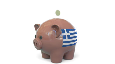 Putting money into piggy bank with flag of Greece. Tax system system or savings Live Action