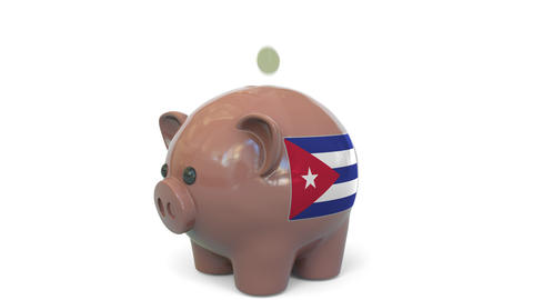 Putting money into piggy bank with flag of Cuba. Tax system system or savings Live Action